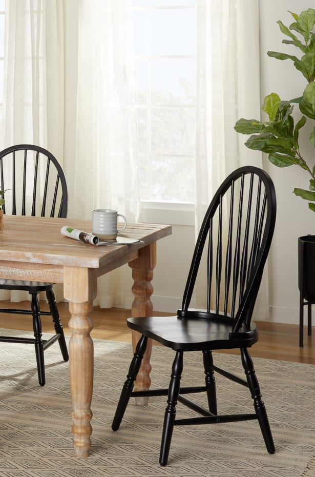 How to Decorate a Dining Room With Black Furniture: Mismatch Your Dining Table and Chairs