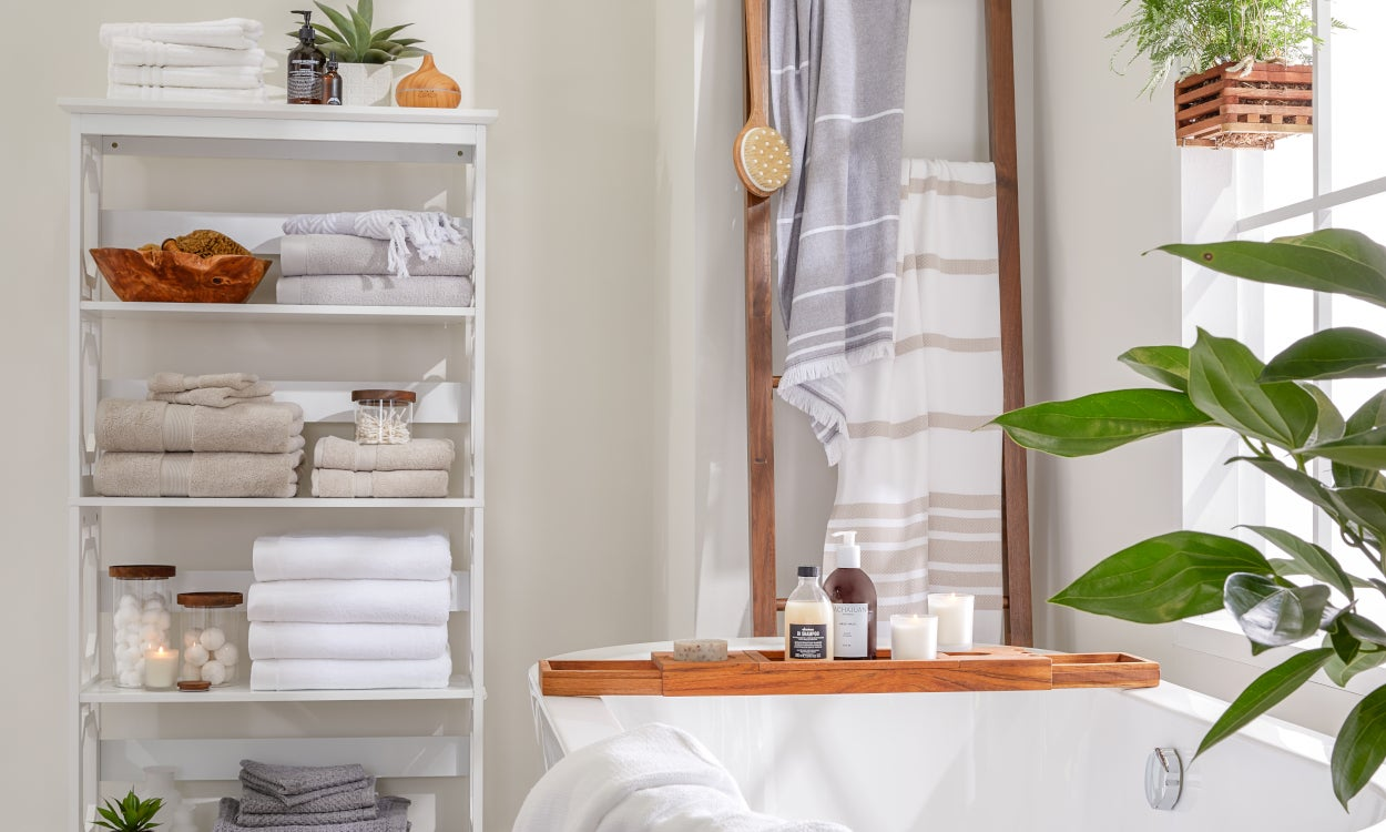 A bathroom with an organized linen shelf