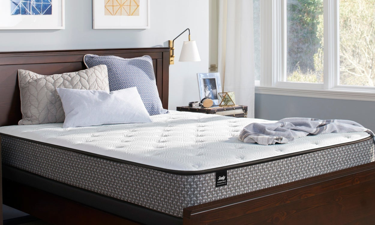 Queen sized mattress on a bed frame