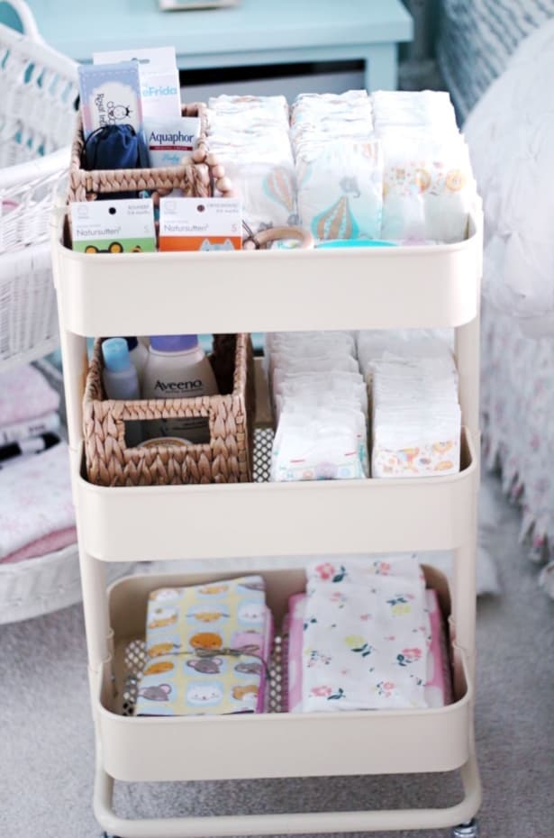 Storage cart setup with diaper changing supplies.