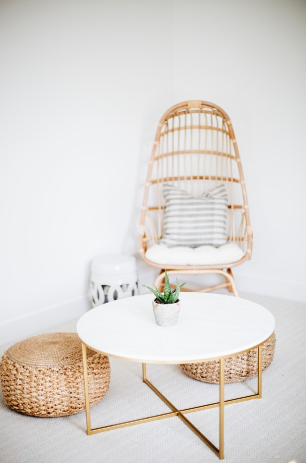 Living room with round coffee table, round poufs, and rounded chair