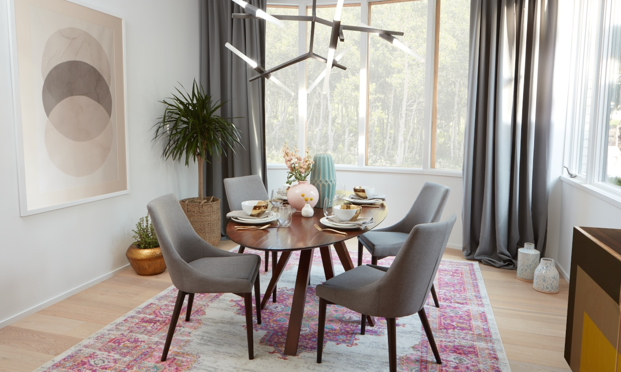 A dining room featuring a colorful rug