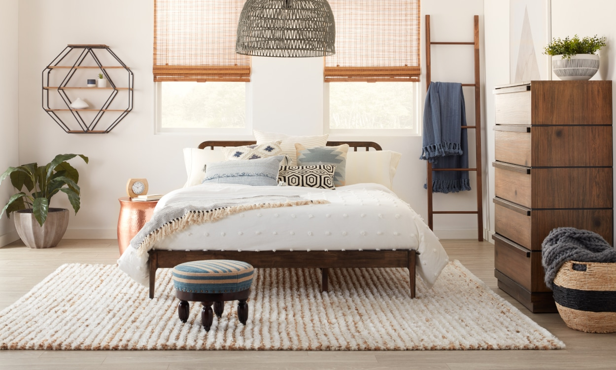 Bedroom featuring a rug created by woven materials