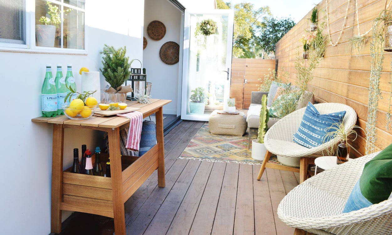 Outdoor patio with a privacy fence