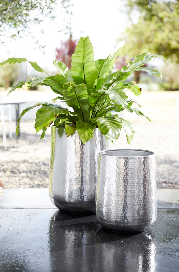 Metallic planters paired together