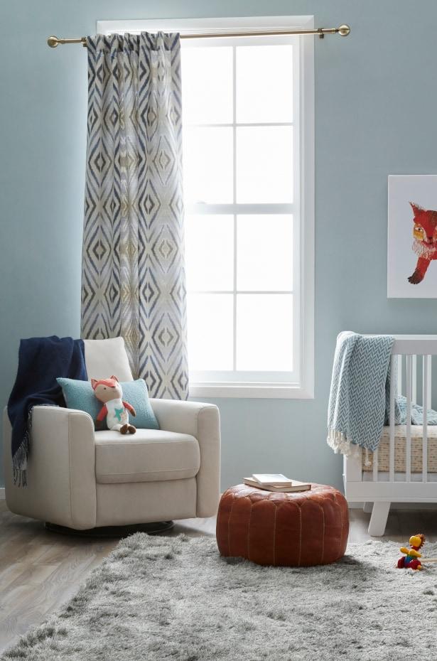 Gray shag area rug in a boy's nursery