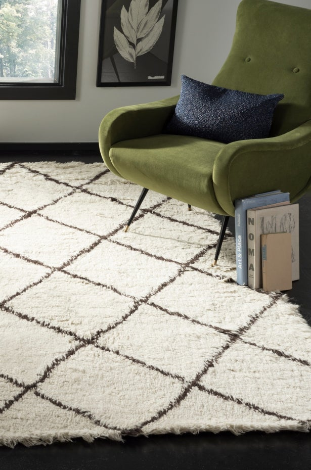 White and gray pattern flokati shag area rug in den.