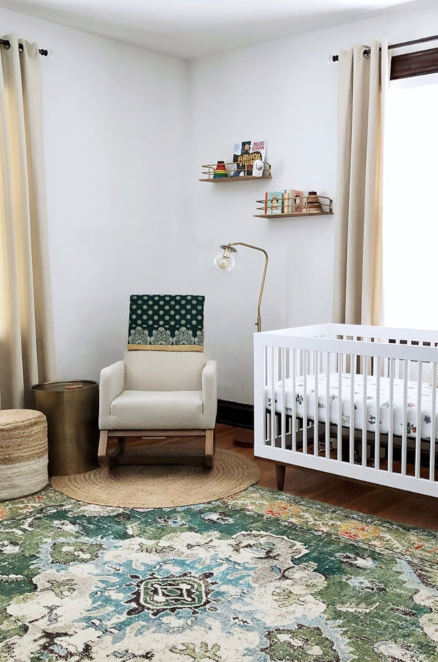 Green and Ivory Oriental rug styled in a Nursery