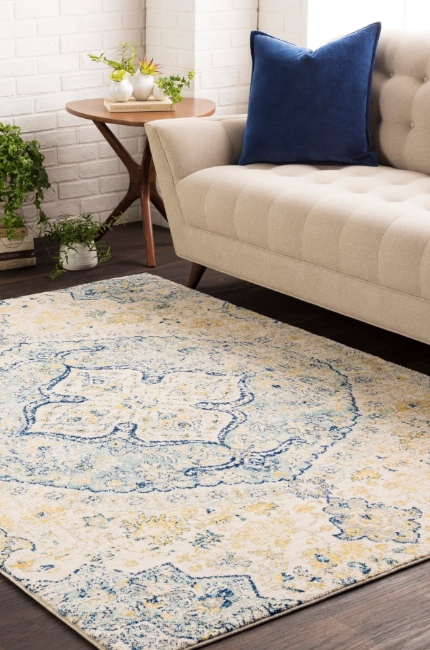 Blue and yellow Oriental rug styled in a living room