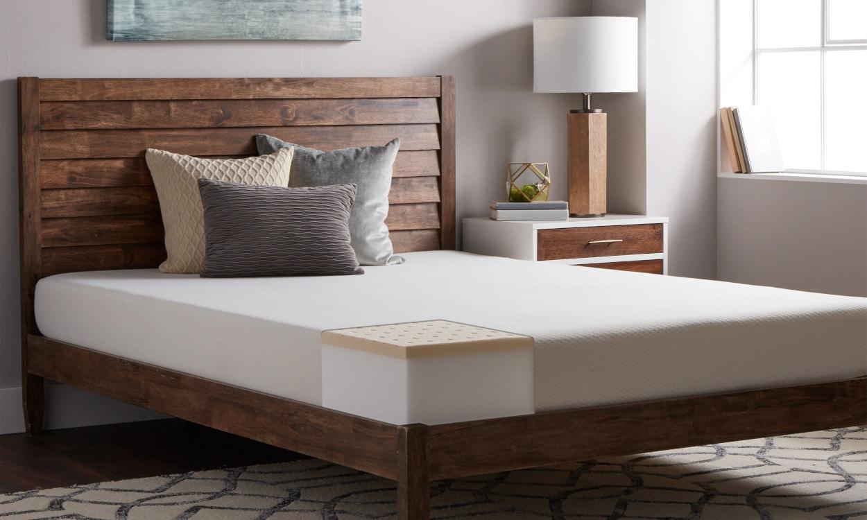 Hypoallergenic latex memory foam mattress on a bed frame