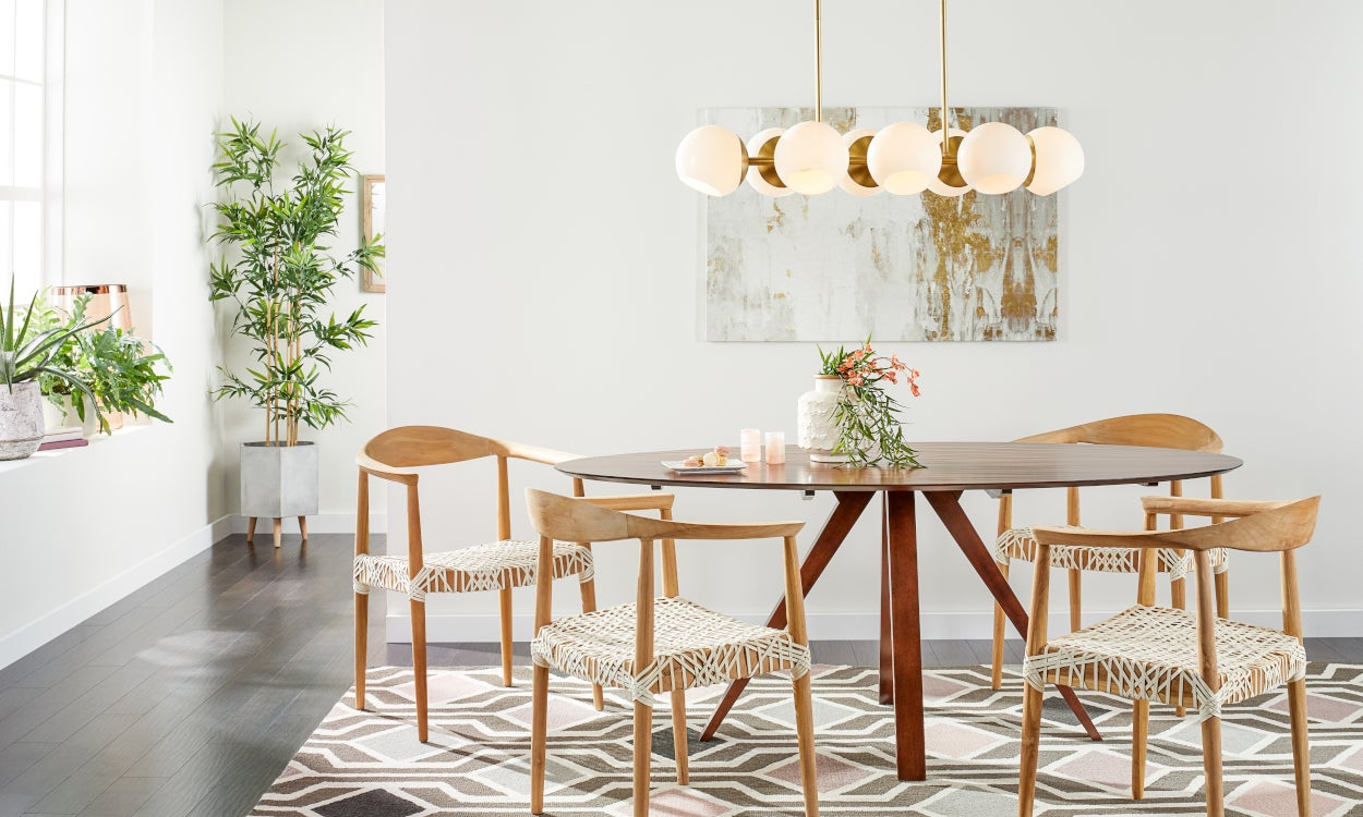 A gold chandelier lighting fixture in a dining room: Home Lighting Design Tips