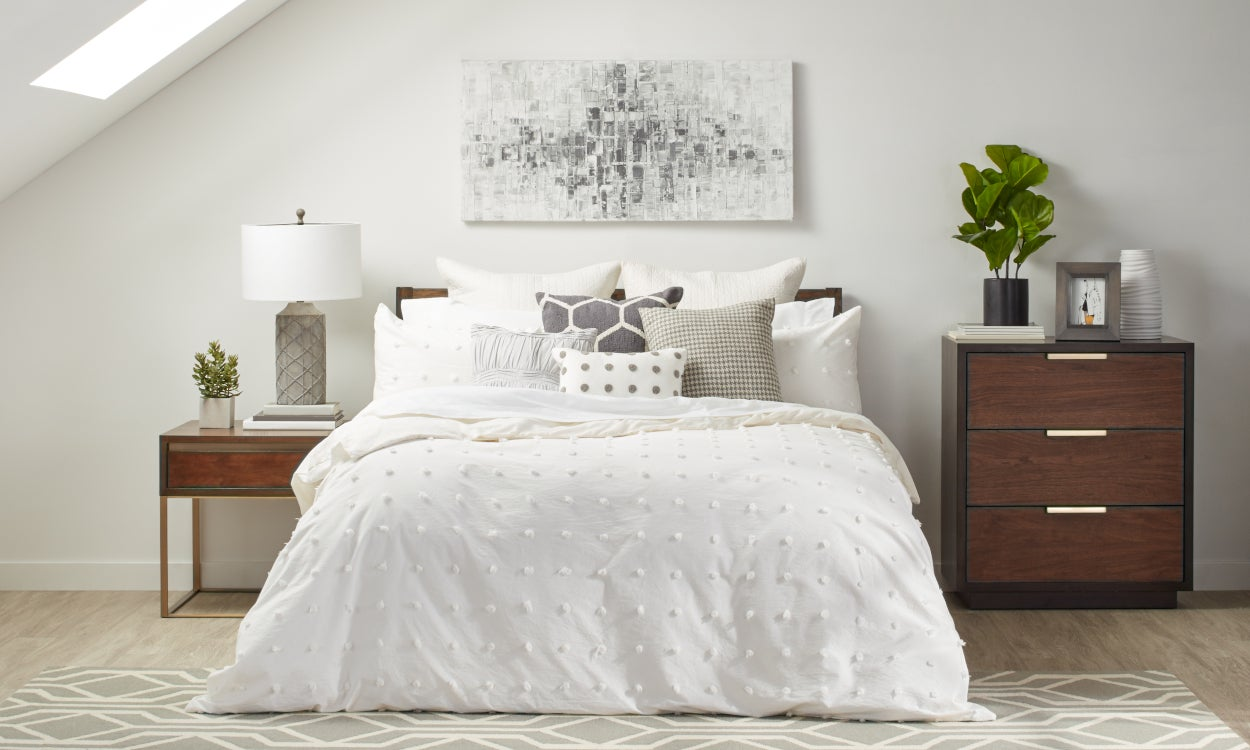 Bedding by season: Duvet cover, sheet set, and pillowcases styled on a bed