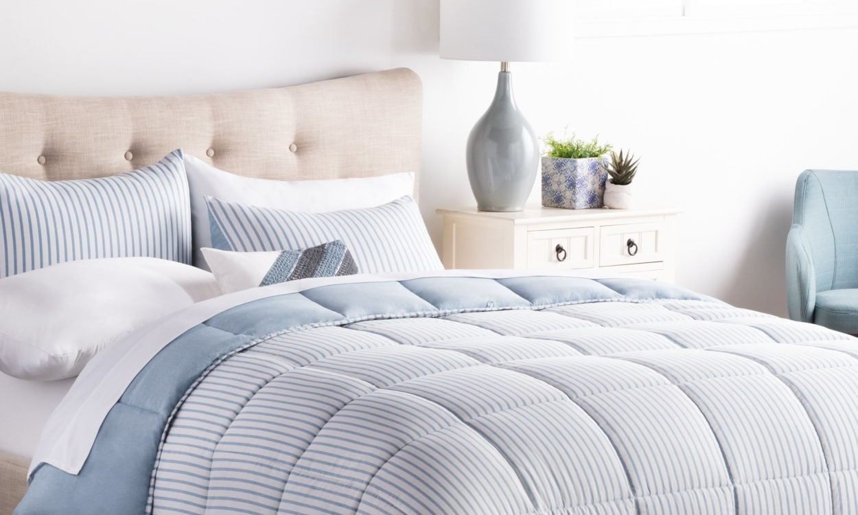 Washed comforter styled on a bed