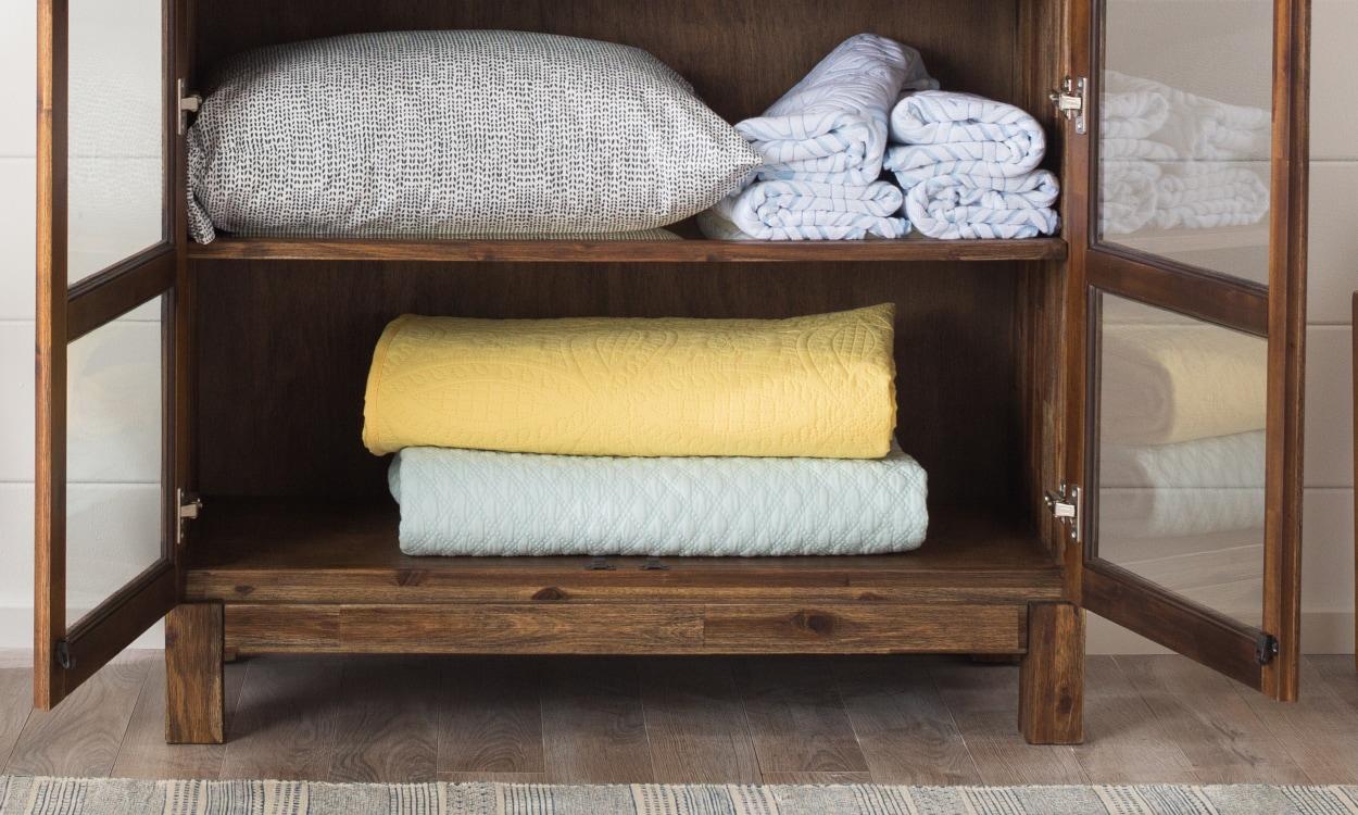 Bedding stored in a linen closet