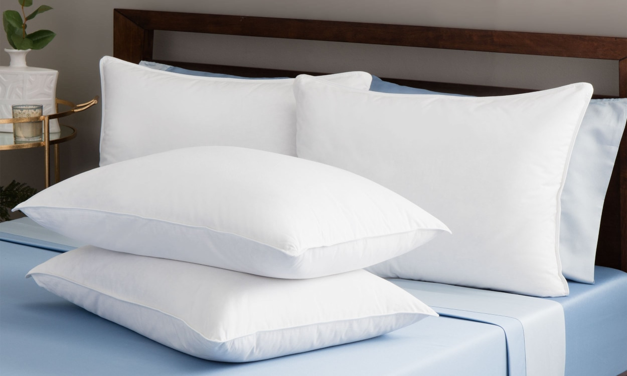 New pillow placed on a bed