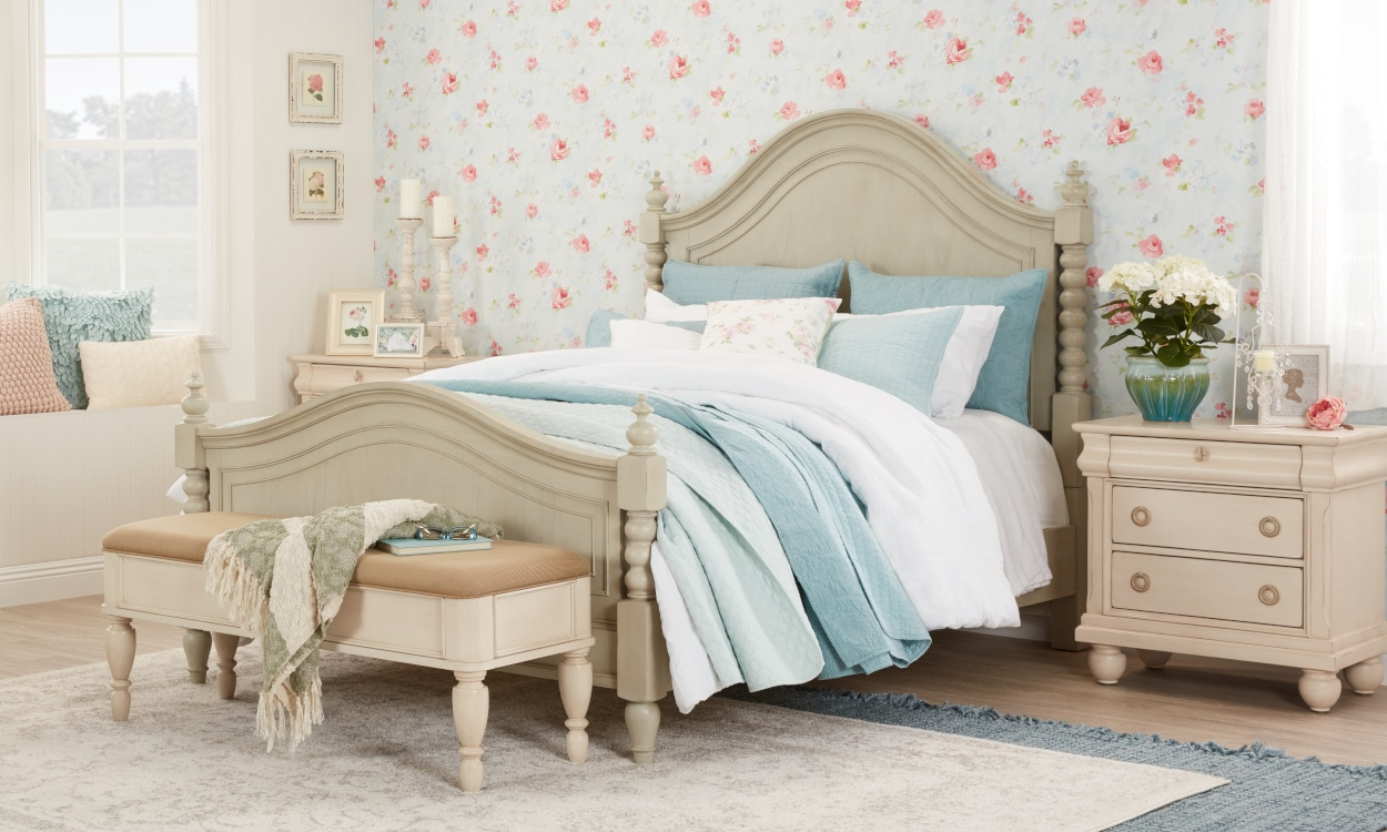 Shabby chic bedroom with pastel and floral bedding