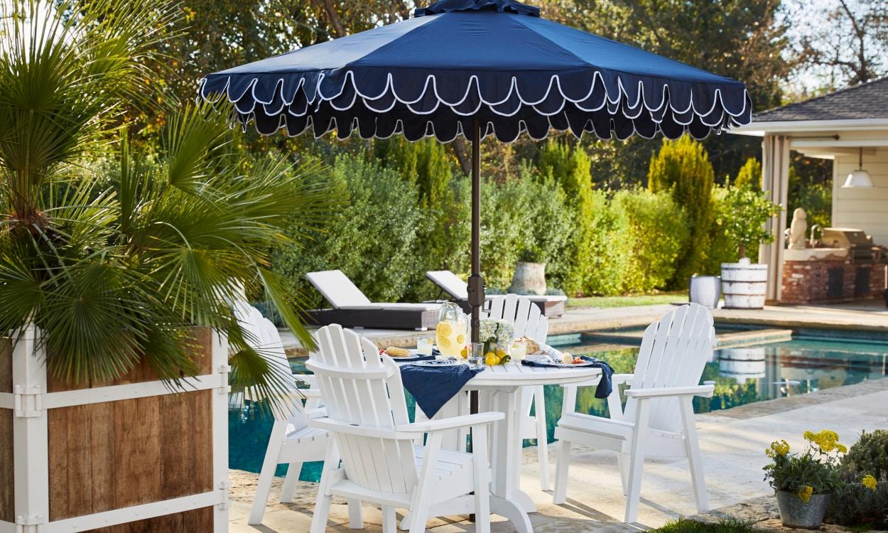 Adirondack Patio Table with a Navy Umbrella providing shade