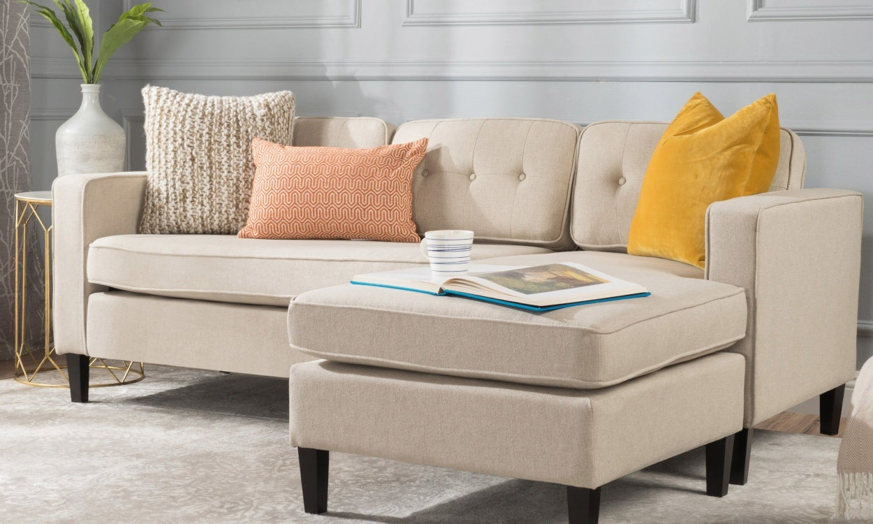 Cream Fabric Chaise Sectional Sofa In A Small E Living Room