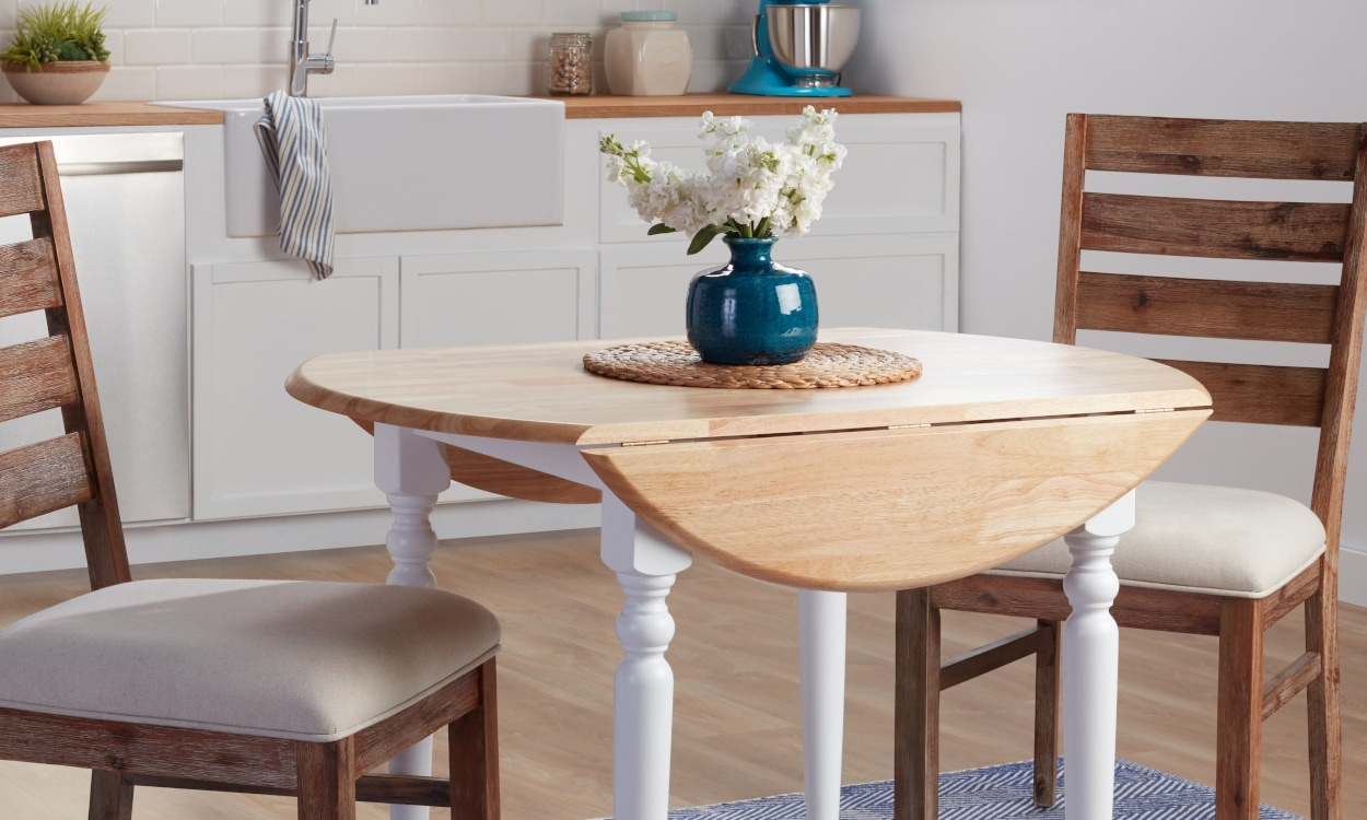 Wooden drop leaf dining table with two chairs for small spaces