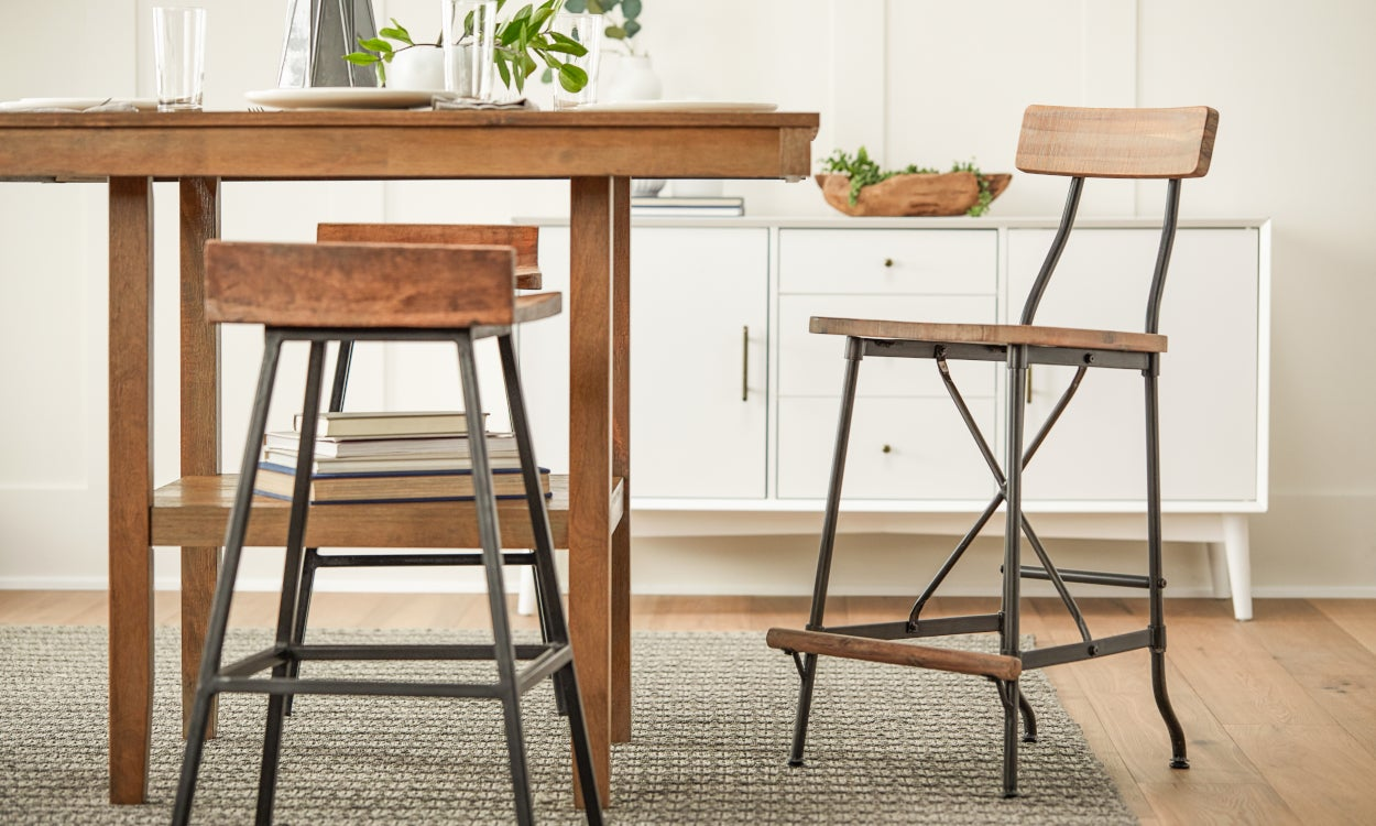 Tall table with bar stools in a small space dining room