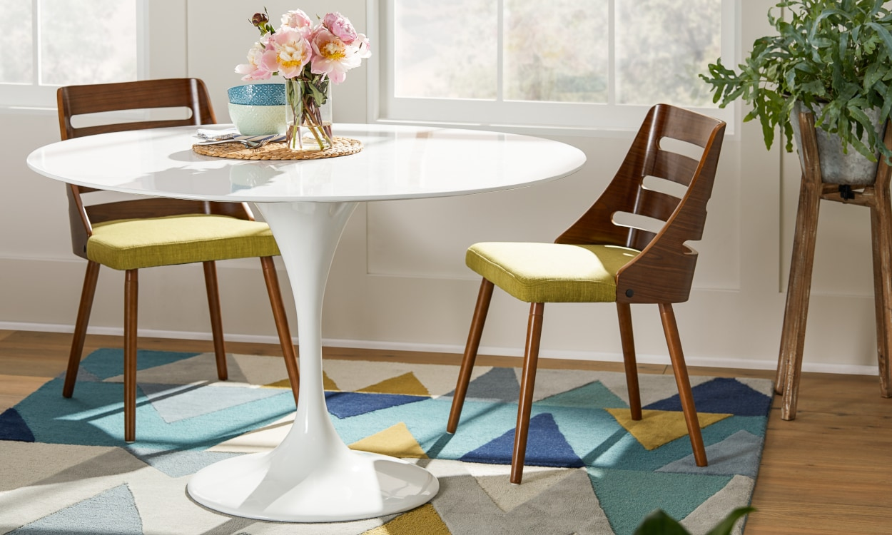 White pedestal table in a small space dining room