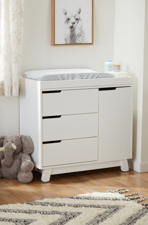 White changing table for a baby nursery with drawers for extra storage