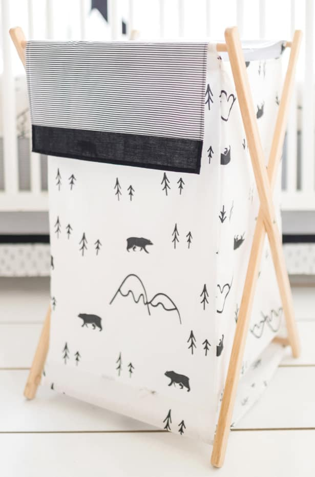 Black and white printed clothes hamper for a baby nursery