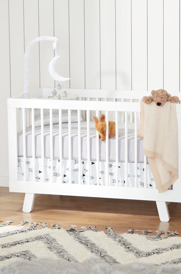 White Babyletto crib for a baby nursery