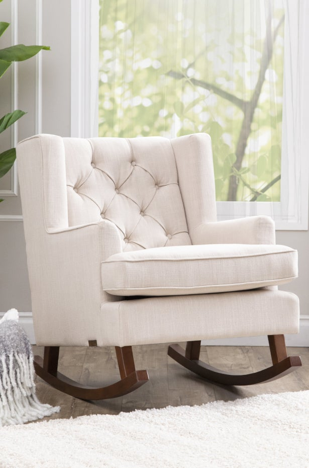 Cream fabric rocking chair for baby nursery