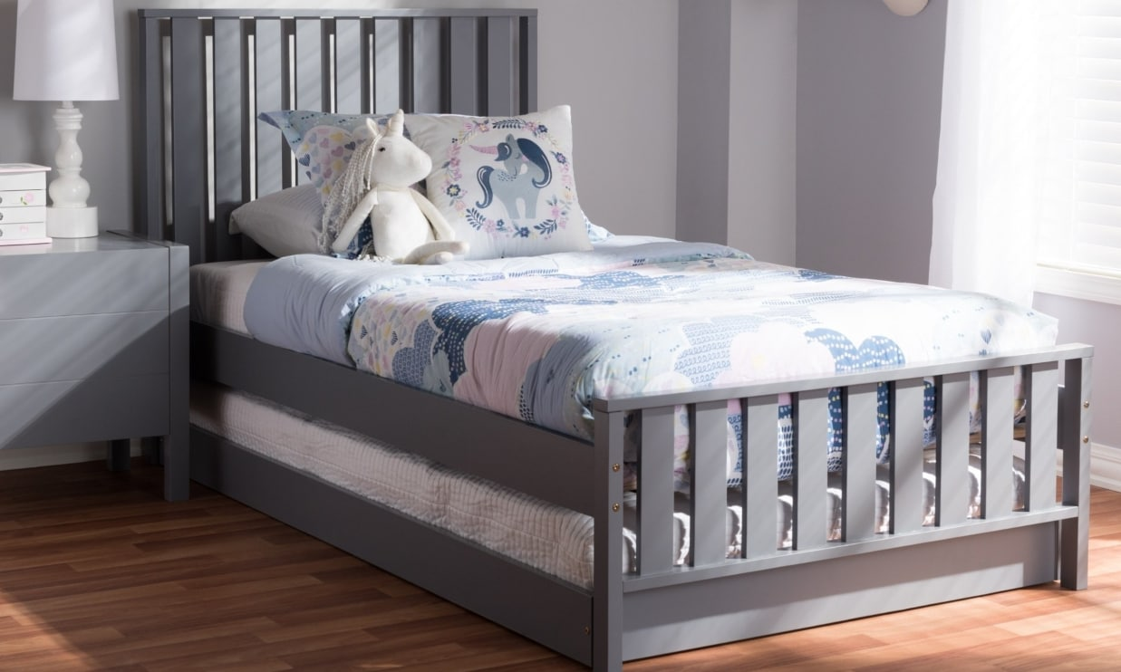 Grey twin sized trundle bed in a kids bedroom