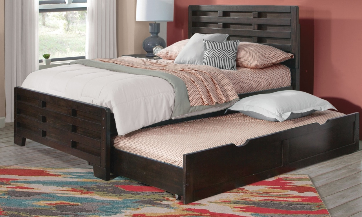 Full size trundle bed in a bedroom