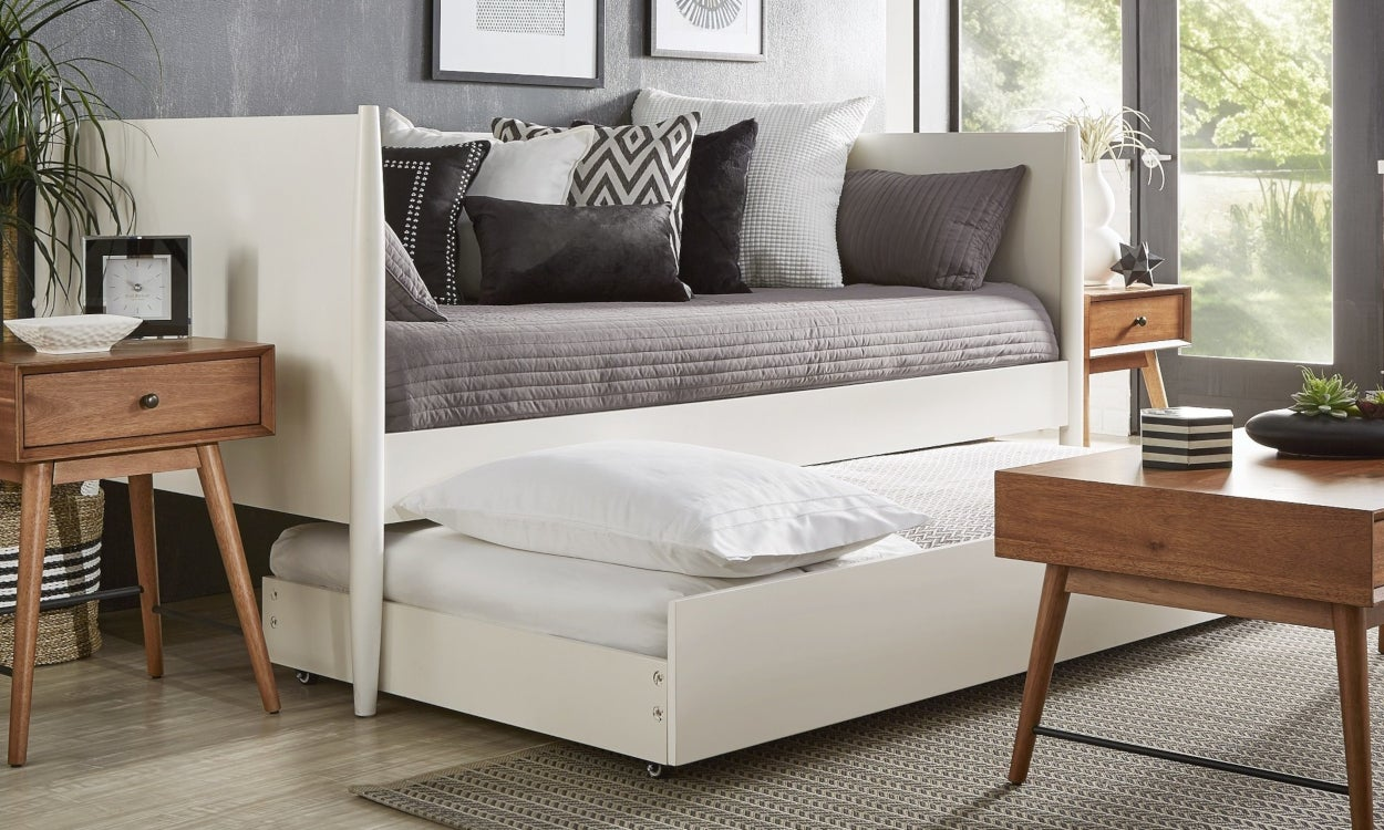 White wood trundle bed in a living room