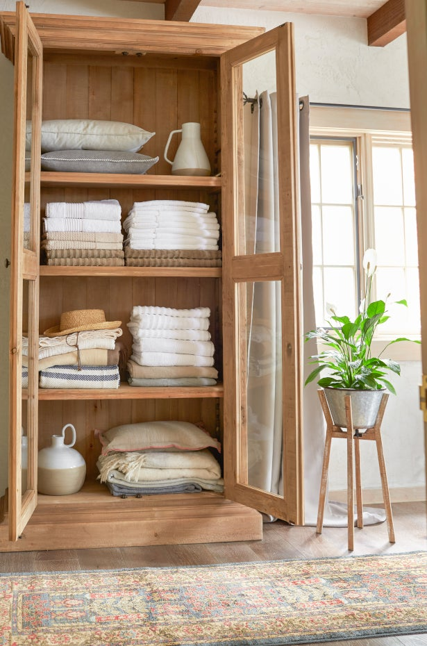 Bath and bed linens in a closet