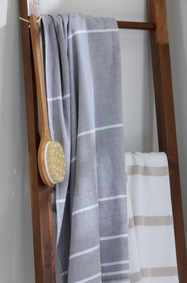 Turkish towels on a ladder rack