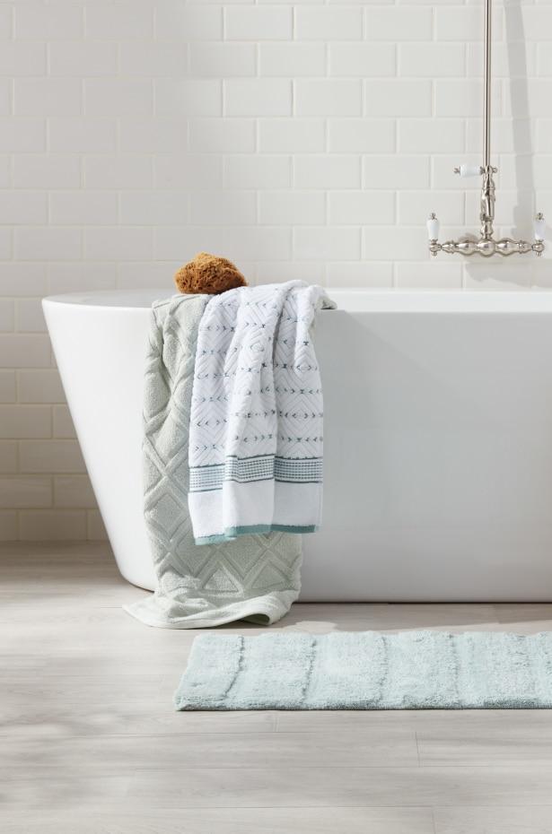 Bath towels in a white bath tub