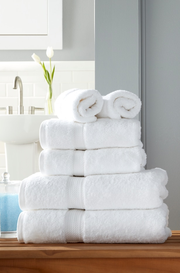 Stack of white folded bath towels and bath sheets