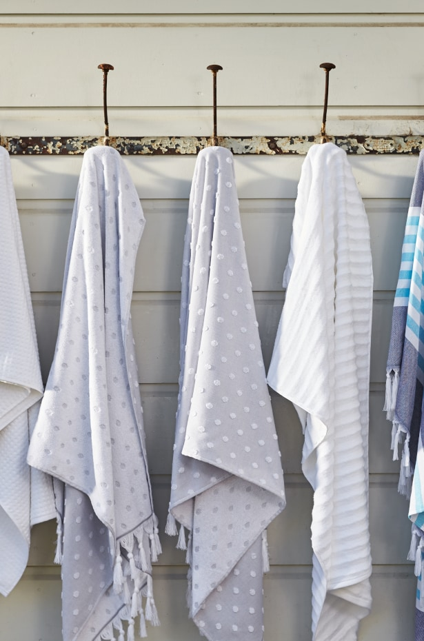 Bath towels and bath sheets hanging on hooks