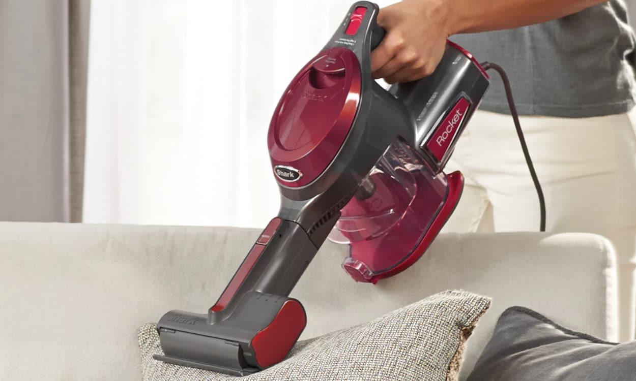 Handheld vacuum, vacuuming a sofa bed