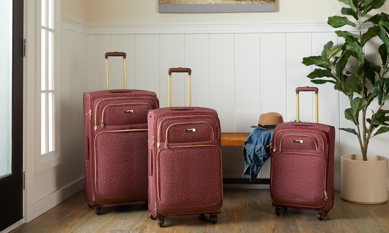 Red luggage in various sizes