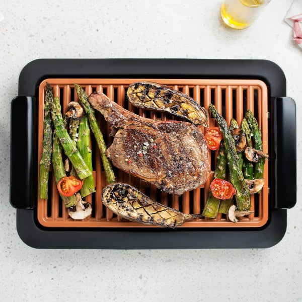 Electric Grill Cooking Steak and veggies - Small Appliances