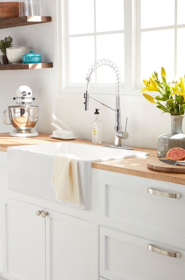 Apron sink in bright kitchen