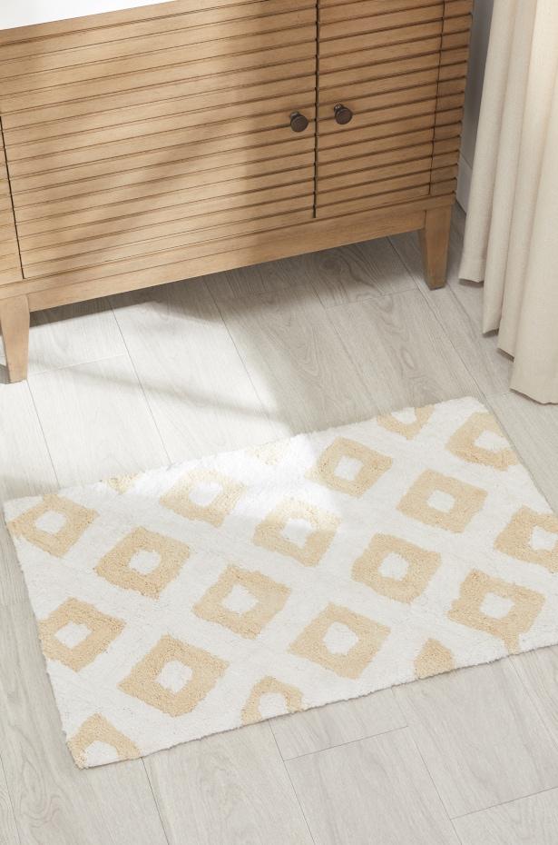 How do you wash a fabric bath mat?
