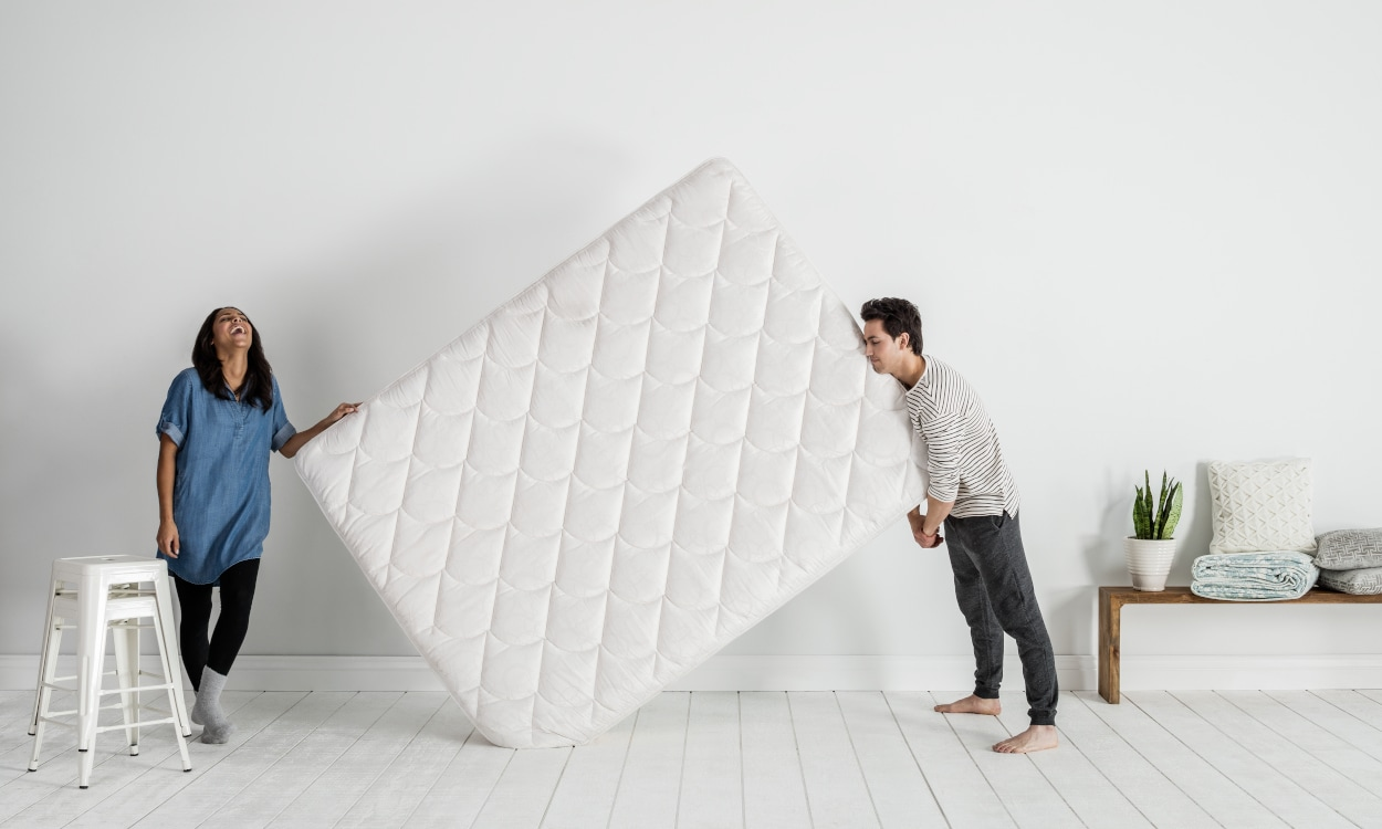 couple buying a mattress